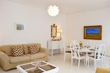 The open plan sitting room/ dining area is spacious and bright