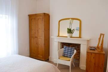 The lovely double bedroom with decorative fireplace