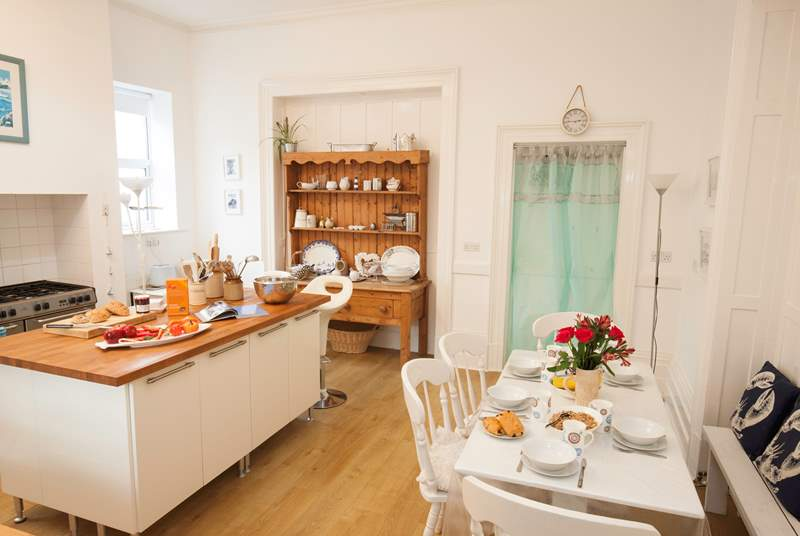 The kitchen is an utter delight with a charming Island separating the kitchen from the breakfast area