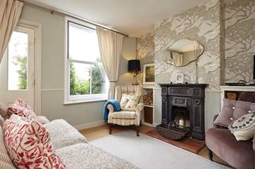 The beautifully styled sitting-room with ornamental fireplace.