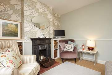 The sitting-room has the original Victorian fireplace (ornamental).