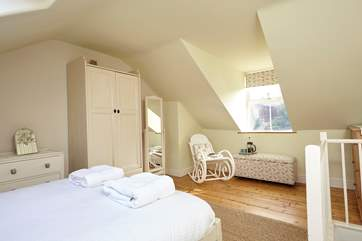 The master bedroom is light, airy and has ample space.