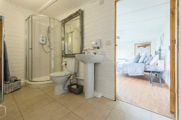 Inbetween the living-room and the bedroom is the en suite shower-room.