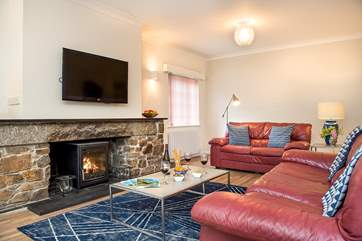 Plenty of room to unwind and relax in front of the wood-burner.