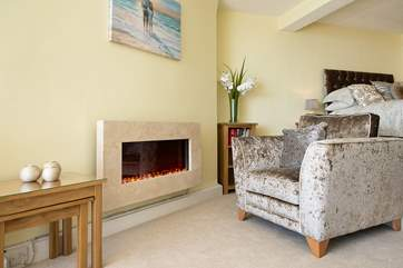 The wall-mounted fire creates a cosy glow making this an ideal retreat all year round.