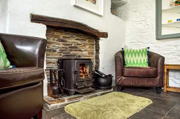 The toasty wood-burner makes this a delightful retreat whatever the weather.