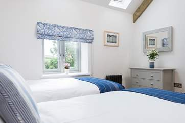 Bedroom two has countryside views.