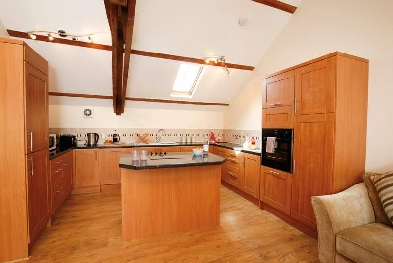 The kitchen is well-equipped and is a delightful and characterful space to cook in