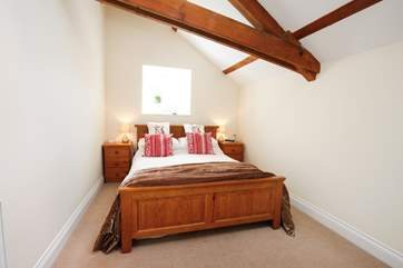 The master bedroom with lovely king-size bed