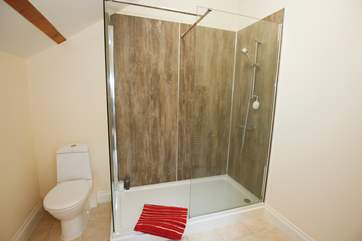 Enjoy your morning shower in this spacious shower off the master bedroom