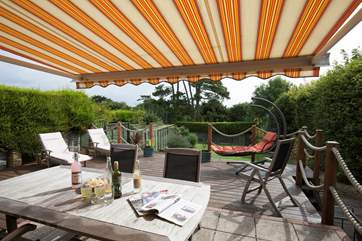 The awning in the garden is perfect for providing shade in the hot summer sunshine.