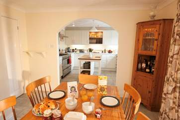 The open plan kitchen/dining-area is a delightful space to entertain and unwind.