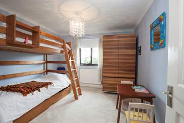 The third bedroom has bunk-beds ideal for children.