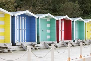 Why not hire a colourful beach hut?
