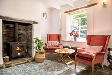 There are beautiful features throughout, orginal slate floors, hand-made window shutters and of course the toasty wood-burner which makes this an ideal retreat whatever the weather.