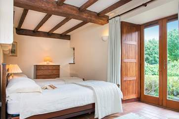 Double doors lead out from the twin bedroom to the garden.