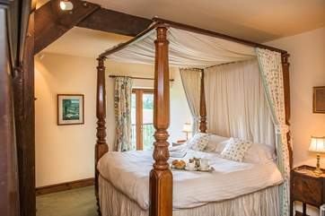 Bedroom 3 has a fabulous four-poster bed.
