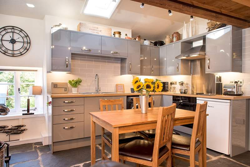 The stylish kitchen and dining areas.