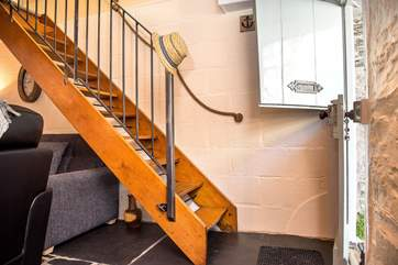 The open-tread stairs that lead up to the bedroom.