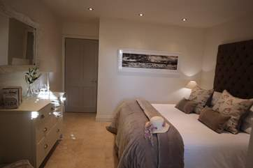 The spacious master bedroom is beautifully decorated and creates a relaxing aura