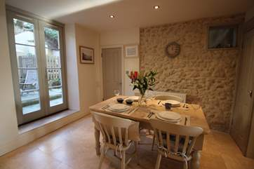 The original stone wall brings huge character and charm to the apartment