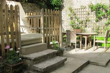 The courtyard to the rear of the property is fully enclosed