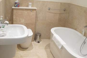 The family bathroom with free standing contemporary oval bath, perfect for a calming bubble bath