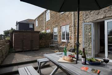 The Guardhouse has a spacious terrace and is attached to the cottage next door.