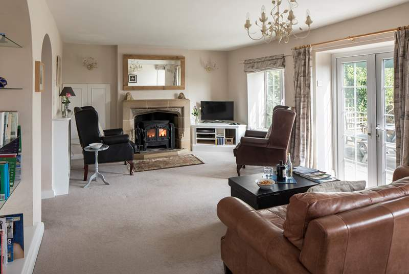 Enjoy the morning sun in the sitting-room, which has a cosy wood-burner for less sunny days and for winter escapes.