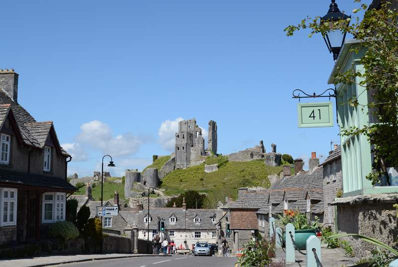 The National Trust's Corfe Castle on the Isle of Purbeck; the nearby coastline has sandy beaches that offer watersports hire during the summer season.
