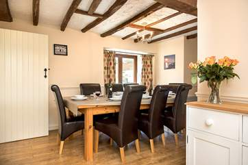 Aldercombe Barn has a separate dining-room with patio doors leading out to the garden.