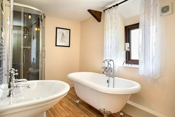 The main family bathroom has a fabulous free-standing bath.