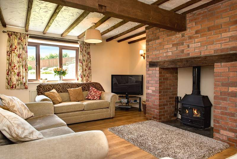 The cosy sitting-room has plenty of space for all to relax and unwind and the toasty wood-burner is a welcome sight on those winter escapes.