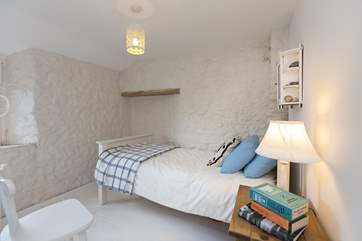 This is the pretty single bedroom with views out over the garden and the countryside beyond.
