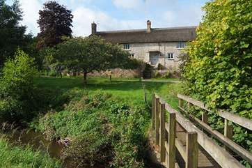 As well as the gardens around the farmhouse there is a little meadow and a little bridge over the river (please supervise children at all times).
