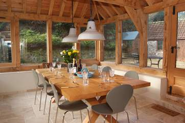 There is an oak-framed extension which has a table that is large enough for the 12 guests that this wonderful house accommodates. This is the 'new' dining-room or garden-room.