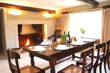 The 'old'  dining-room at the heart of the house has a huge open fireplace and a beamed ceiling.