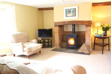 This is the main living-room with its wood-burning stove and deep comfortable sofas.