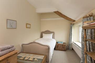 This lovely single bedroom looks out to the front of the farmhouse. The family bathroom is across the corridor