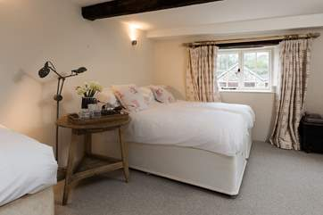 This is the lower ground floor bedroom. This room sleeps 3 guests. The outlook is to the lovely enclosed front garden.