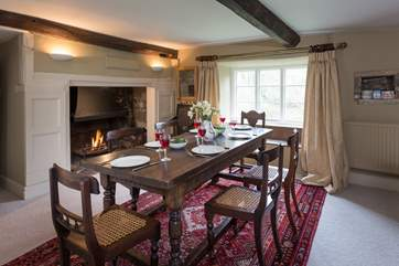There is a 'formal' dining room in one of the panelled reception rooms, complete with a huge inglenook fireplace and open fire.