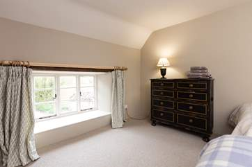 The outlook from this bedroom is at the near end of the farmhouse as you approach down the lane