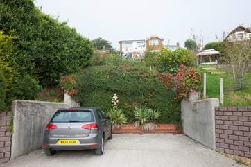 At the bottom of the garden is private parking for two cars