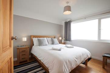 The master bedroom with king-size bed with lovely sea views