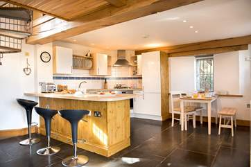 The kitchen and dining areas sit at one end of the open plan living-room.