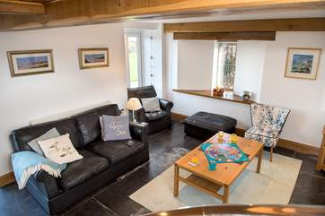 The open plan living-room is light and airy and the  large windows take full advantage of the views.