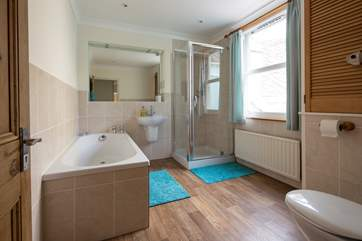 Large family bathroom offering a bath and shower cubicle.