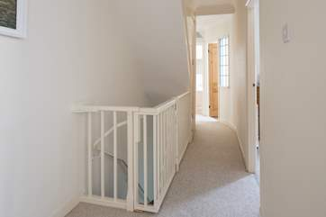 First floor hallway, clever baby gate ensures little ones can't find their way down the stairs to the ground floor, however be aware that there is another flight of stairs to the second floor.
