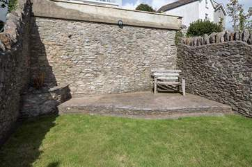 Why not sneak off with a good book and sit back and relax in the property's raised garden area.