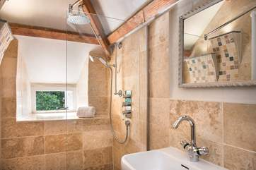 The stylish en suite shower-room to bedroom 1.